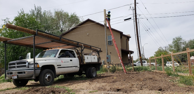 Electrician on temporary power pole